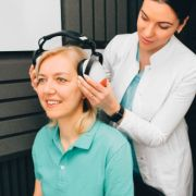 woman getting hearing exam