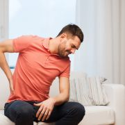 Man with chronic back pain. Syda Productions/Shutterstock