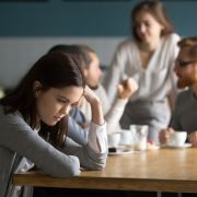 Introverted girl not joining in group. fizkes/Shutterstock