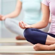 People meditating. AboutLife/Shutterstock