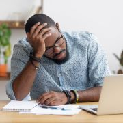 Man struggling with perfectionism. fizkes/Shutterstock