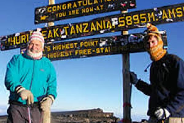 Gutkind and son at the summit of another mountain, Mount Kilimanjaro in Tanzania