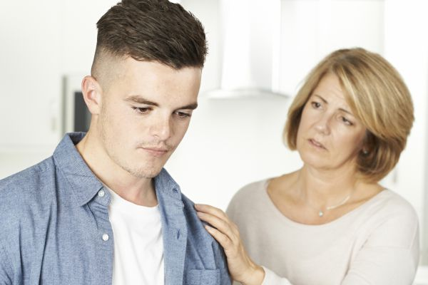 Mother Worried About Unhappy Teenage Son.