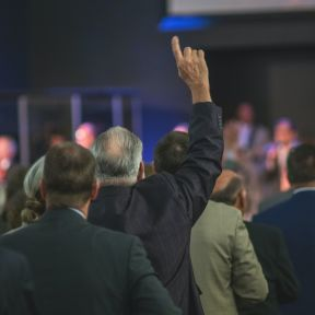 One man testifying at a Pentecostal rally