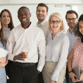 Positive multi racial corporate team posing looking at camera stock photo