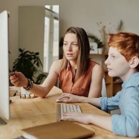 Woman tutoring young boy