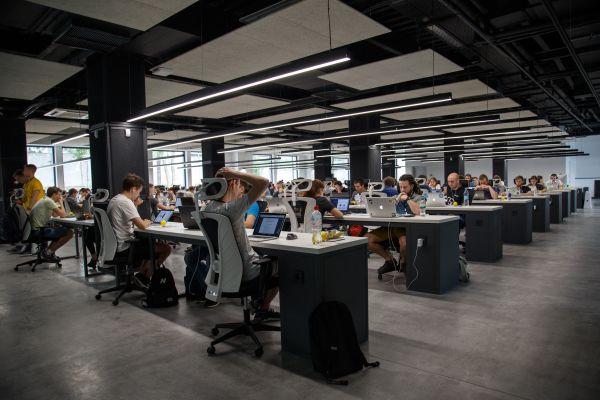Room full of people working at desks