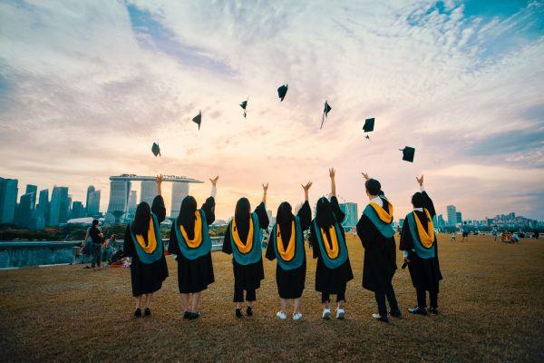 Graduates throwing caps and celebrating