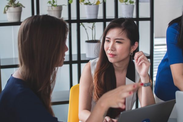 Two Women in Serious Conversation