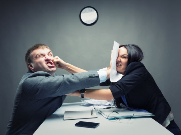 Two business people shoving each other