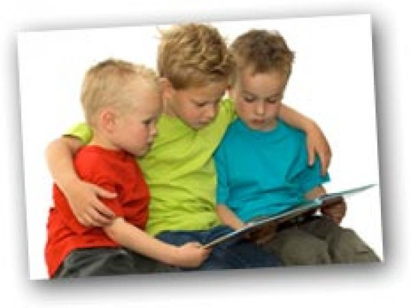 Older brother reading to younger ones