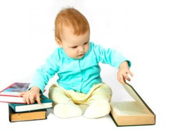Child with stack of books