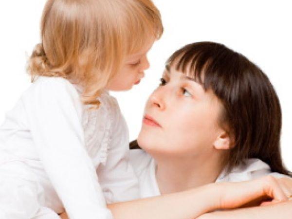 Mom looking sadly at daughter.
