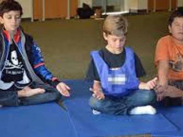 Meditating in lotus pose in public school yoga program