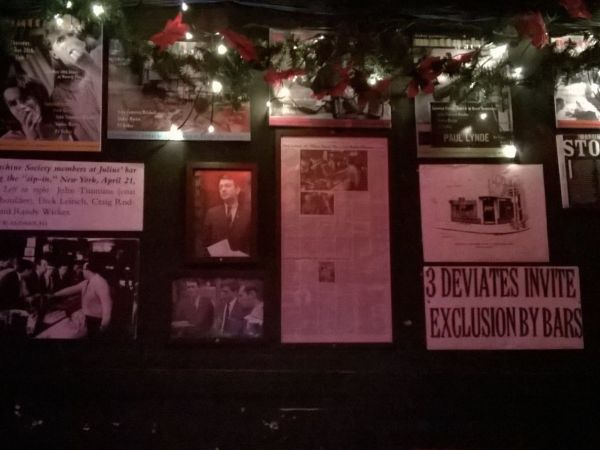 Mementoes and framed photos of gay heroes and important moments in LGBTQ history adorn the walls of Julius' in New York City.