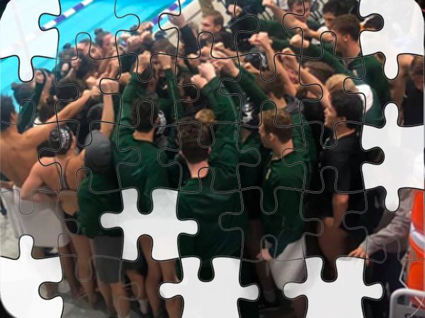 The College of William & Mary, known as 'the Tribe' highlighting their unity, join together in a cheer before a competition.