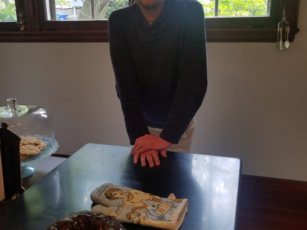 Nat stands proudly over his angel food cake with chocolate ganache glaze