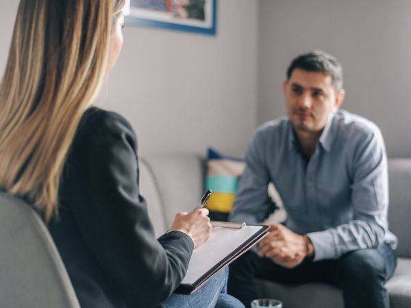 A therapist meets with a client.