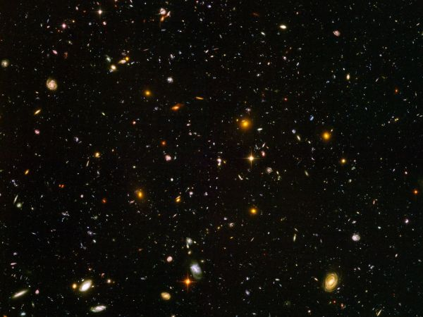 The Hubble Ultra Deep Field. Almost 10,000 galaxies. Looking back to when the universe was less than a billion years old.