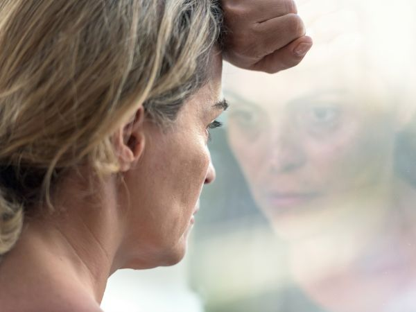 Woman struggles with her mental health.