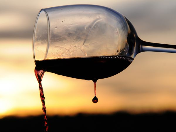 Pouring out wine.
