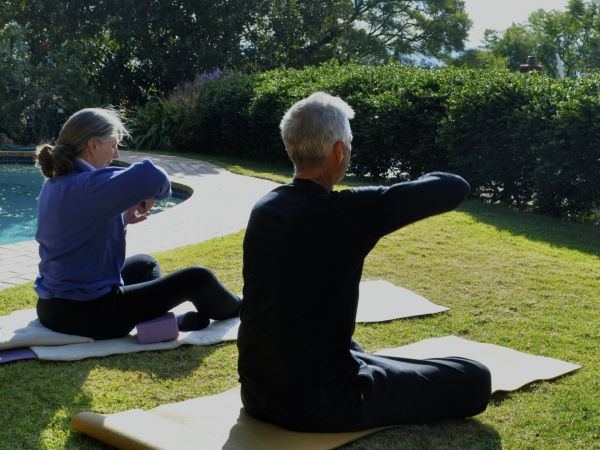 Decade-long daily routine: yoga on the lawn