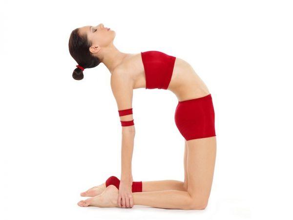 Young woman doing yoga pose