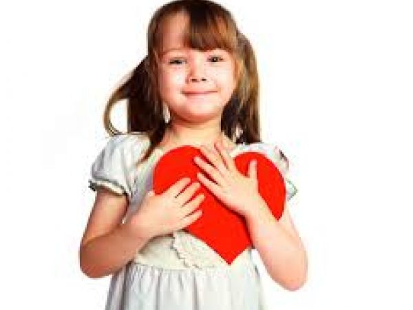 Girl with big red paper heart