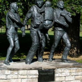 A flood disaster memorial in Fort Collins, Colorado depicting roles for men and women.