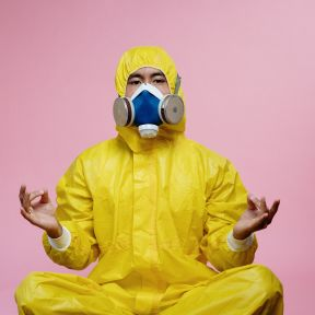 Man in yellow protective suit.