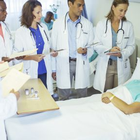 Hospitalized patients are often surrounded by students.